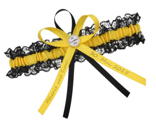 Schwarz gelbes Strumpfband aus Spitze und Satin.