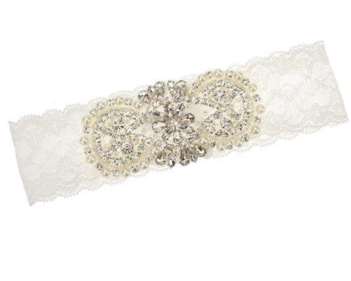 Strumpfband aus Spitze mit Strass und Perlen.